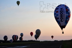 Hot air balloons fly during the 23 th FAI Hot Air Balloon Czech Championship in Jindrichuv Hradec in the Czech Republic. Twenty five contestants from eleven countries participate in the event. The event starts at the airport in Jindrichuv Hradec.
