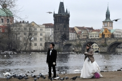 A bridal couple is seen after Their marriage on Vltava River