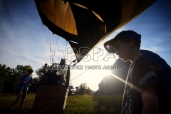 Hot air balloons above Czech Paradise. A pilot's flying in the Czech Paradise. A Balloonist Lubos Baloun from Balloon team prepares for takeof.