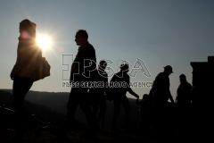People enjoy the mornings sunshine along the Znojmo