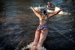 Polar swimmers take part in the traditional swim in the Jizera River