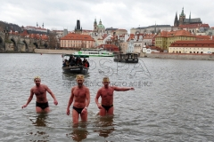 Participants join the traditional New Year's Winter swimming in the Vltava