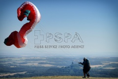 A Paraglider Michal Kolarik of Czech Republic prepare to take off from a Kozakov