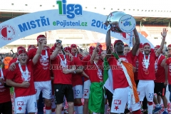 Players of Slavia Prague celebrate with a trophy after winning the Czech first league 2016-2017.